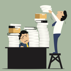 stack of papers on desk.png